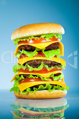 Tasty and appetizing hamburger on a blue
