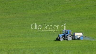 Farm tractor spraying field