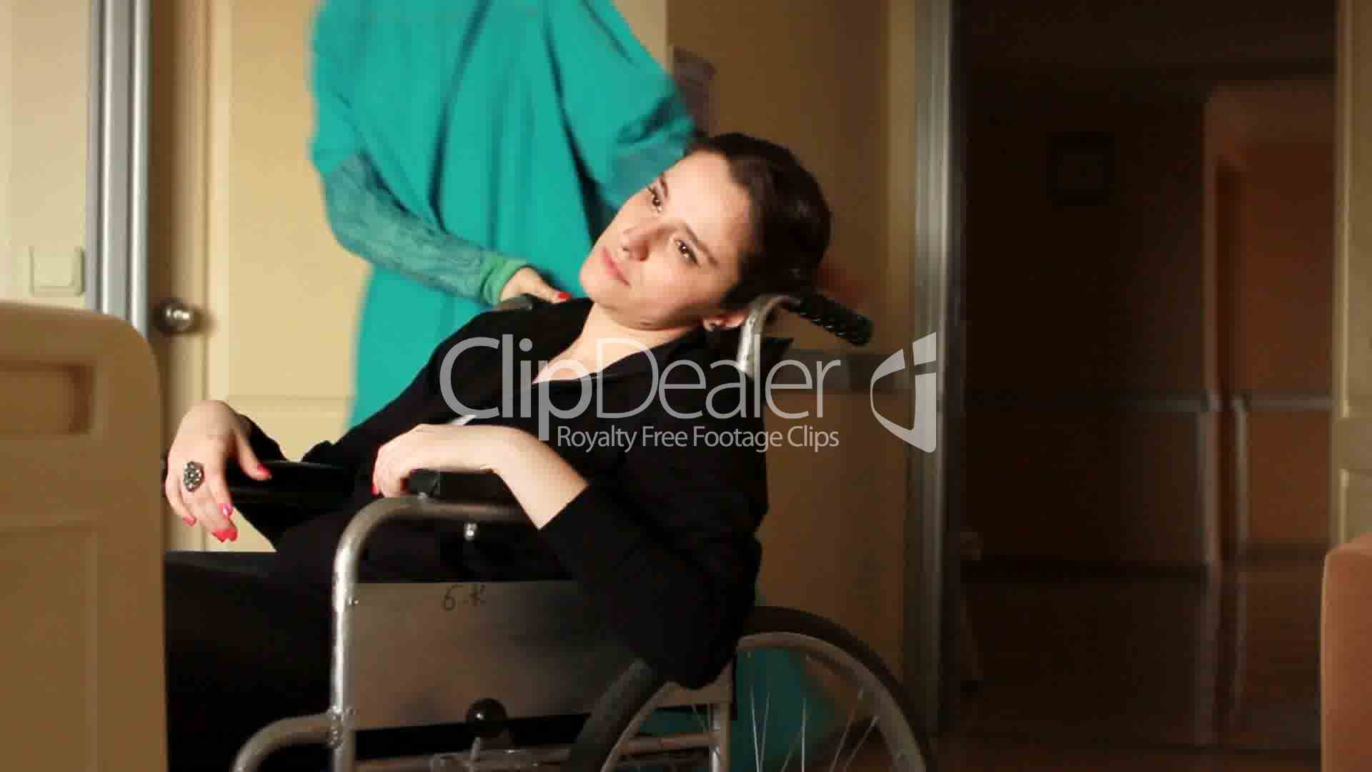 Nurse Carrying Patient On A Wheelchair 2 Royalty Free