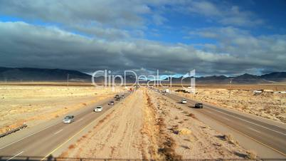 Busy Traffic on Desert Highway