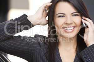 Beautiful Hispanic Woman Businesswoman Using Cell Phone