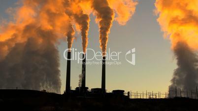 Power Station Chimneys Smoke at Sunrise