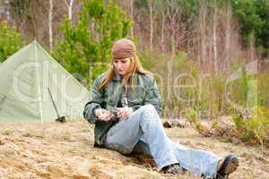 Camping woman tent nature cut stick
