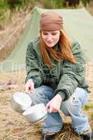 Camping woman tent washing dishes nature