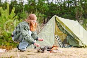 Camping woman tent cook food fire nature