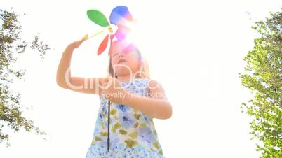 Little Blonde Girl with Pin Wheel