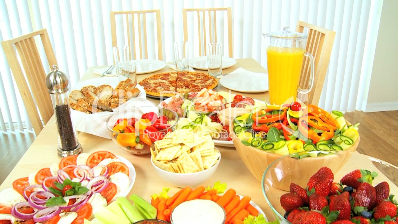 table full of fresh healthy food royalty free video and stock footage. Black Bedroom Furniture Sets. Home Design Ideas