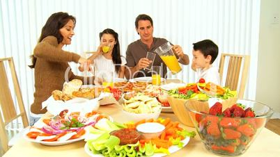 Young Family Enjoying  Healthy Lifestyle Food