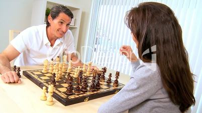 Caucasian Couple in Chess Game