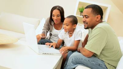 African American Family Sharing a Laptop