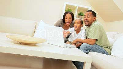 African-American Family Using Internet Webchat