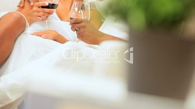 Happy Young Ethnic Couple Drinking Wine