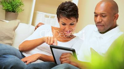 African-American Couple Using Wireless Tablet