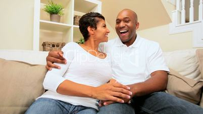 African-American Couple Using Interactive Technology