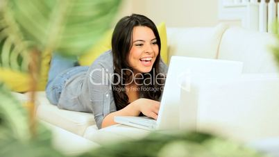 Brunette Girl at Home Using a Laptop