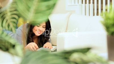 Girl Relaxing with a Book & Juice