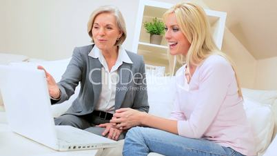 Female Client Meeting with Financial Advisor at Home