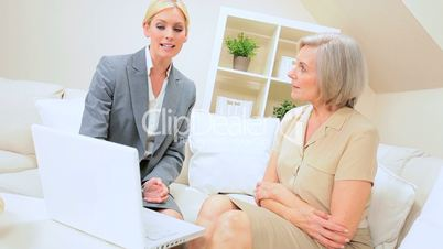 Mature Lady Client Getting Financial Advice at Home
