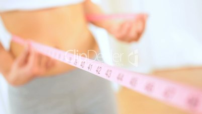 Young Female Using Waist Measuring Tape