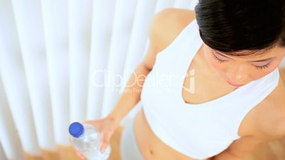 Asian Girl Drinking Water After Exercise