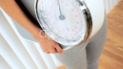 Asian Girl with Weighing Scales & Apple