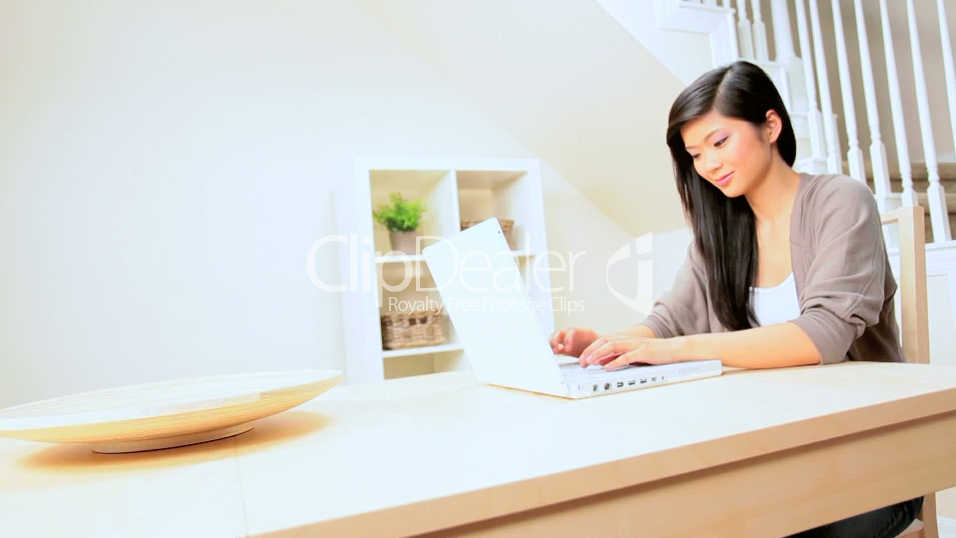 Asian Girl At Home With Laptop Royalty-Free Video And Stock Footage-9428
