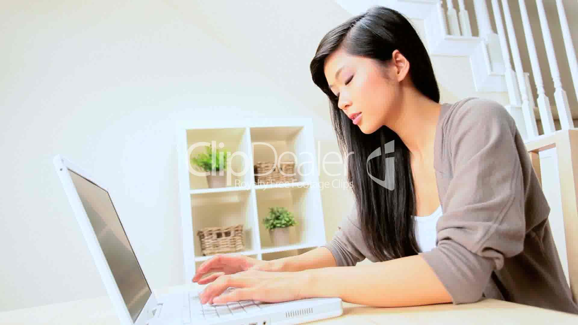 Asian Girl At Home With Laptop Royalty-Free Video And -4881