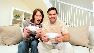 Caucasian Couple Competing on Games Console