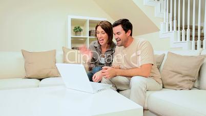 Caucasian Couple Using Internet Webchat