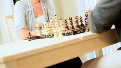 Female Winning in Game of Chess with Husband