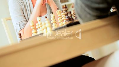 Female Winning Chess Game with Husband