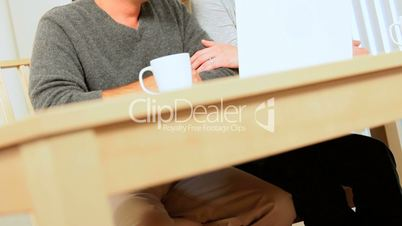 Relaxed Young Couple Using Internet Webchat
