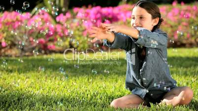 Female Child in Garden with Play Bubbles