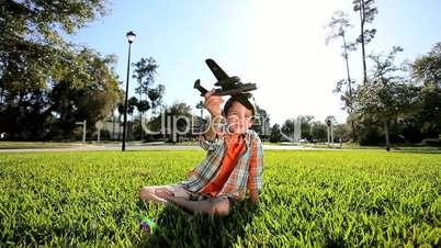 Little Caucasian Boy with Flying Dreams