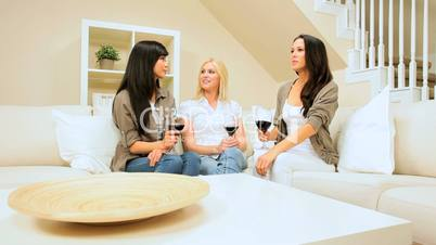 Girlfriends in Home Setting Drinking Wine