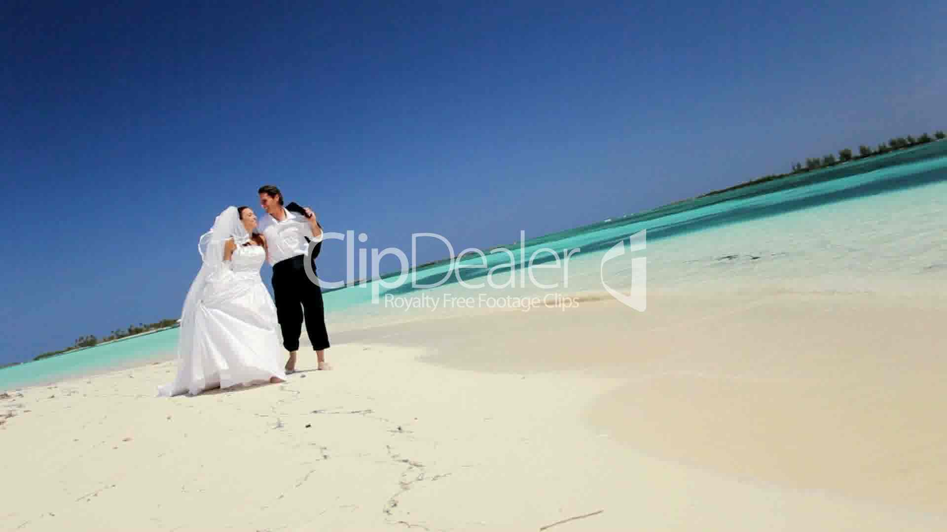 Barefoot Beach Wedding Couple: Royalty-free video and stock footage