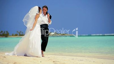 Wedding Couple Laughing & Dancing on the Beach