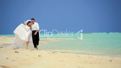Caucasian Couple in Wedding Clothes on a Beach