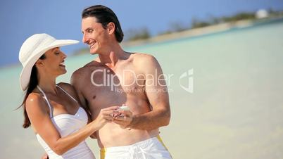 Beach Vacation Couple with Camera