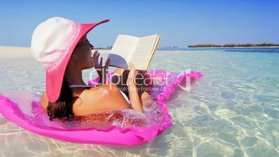 Beautiful Female on Floating Bed Reading a Book