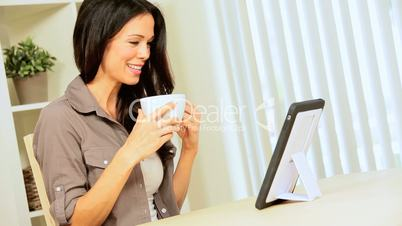 Brunette with Wireless Tablet & Coffee