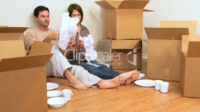 Caucasian Couple Surrounded by Moving Boxes