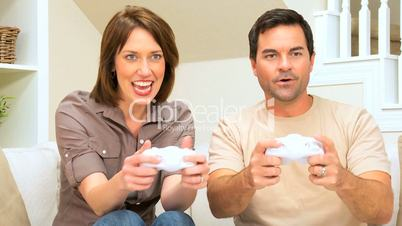 Caucasian Couple Playing on Games Console