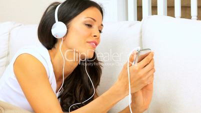 Female Relaxing & Listening to Music