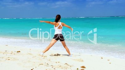 Healthy Female Doing Muscle Stretches on Beach