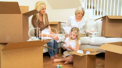 Three Generations of Family Unpacking After House Move