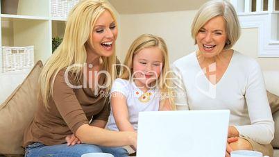 Family Females Using Laptop for Entertainment