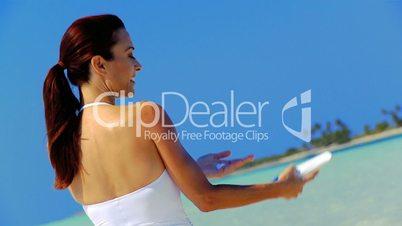 Slim Caucasian Female Using Sun Protection Cream