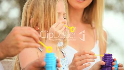 Blonde Little Girl in Close-up With Play Bubbles