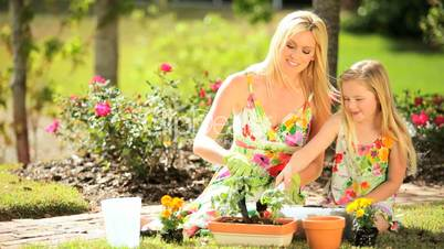 Blonde Mom & Daughter Gardening